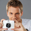 Portrait of a young man with a camera — Stock Photo #6255359