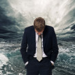 Ocean storm behind businessman - Stock Photo