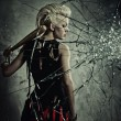 Punk girl with a bat behind broken glass — Stock Photo #6255420