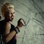 Punk girl behind broken glass — Stock Photo #6255421