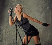 Attractive steam punk singer — Stock Photo