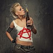 Punk girl smoking a cigarette — Stock Photo