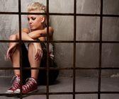 Punk girl behind bars — Stock Photo