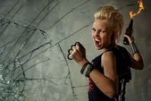 Punk girl behind broken glass — Stock Photo