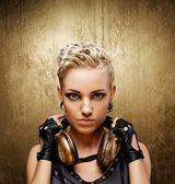 Portrait of an attractive steam punk girl with headphones — Stockfoto
