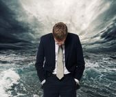 Ocean storm behind businessman — Stock Photo