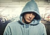 Young handsome man in a hood — Stock Photo