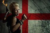 Punk girl with Molotov cockatail against England flag. — Stock Photo