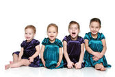 Small, happy girls on a white background — Stock Photo