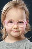 Cute little girl portrait in pink glasses — Stock Photo