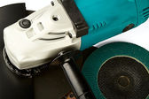 Grinding car and abrasive disks — Stock Photo