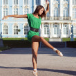 Ballerina is dancing near the palace — Stock Photo