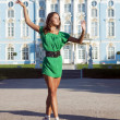 Stock Photo: Ballerinis dancing near palace