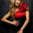 Blonde in a red gown — Stock Photo
