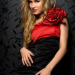 Blonde in a red gown — Stock fotografie