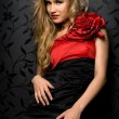 Blonde in a red gown — Stockfoto
