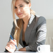 Businesswoman in the office. Break time with cup of coffee — Stock Photo