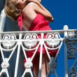 Woman on the balcony. bottom view — Stock Photo #6205461