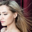 Beautiful blonde with flying hair — Stock Photo