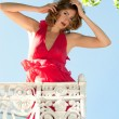 Beautiful woman on the balcony — Stock Photo