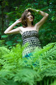 Beautiful woman in the forest. Summer time — Stock fotografie
