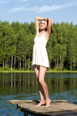 Beautiful woman is standing in the lake. Summer time — Stock Photo
