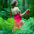 Beautiful woman with naked back In summer forest — Stock Photo