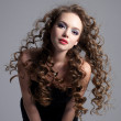 Glamour face of teen girl with long curly hair — Stock Photo