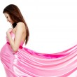 Pregnant woman in rosy dress — Stock Photo