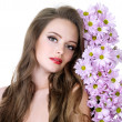 Portrait of woman with flowers — Stock Photo
