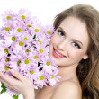 Happy woman with spring flowers — Stock Photo