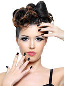Woman with modern hairstyle and black nails — Stock Photo