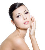 Beautiful woman applying cosmetic cream on face — Stock Photo