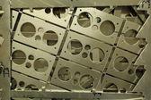 Raw aluminum sheet with holes — Stock Photo