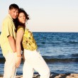 Man and Woman Couple In Romantic Embrace On Beach — Stock Photo #5880156