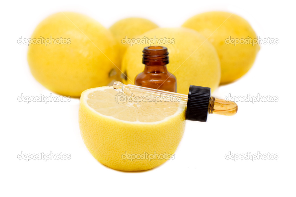 Bottle of essential oil from lemon - alternative medicine.  Stock Photo #6303867