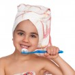 Happy little girl with toothbrush — Stock Photo