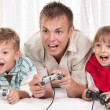 Happy family playing a video game — Stock Photo #6131439