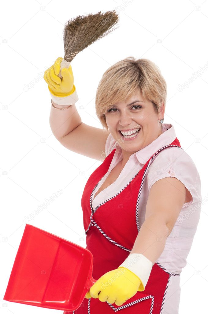 Happy young housewife holding dustpan and broom - isolated on white background — Stock Photo #6131426