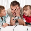 Happy family playing a video game — Stock Photo #6645617