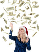 Christmas girl with dollars — Stockfoto