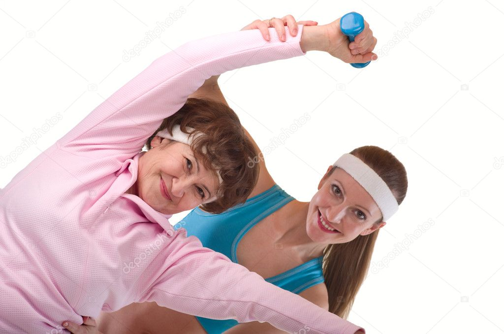 Senior woman exercising in gym with instructor — Foto de Stock   #5618742