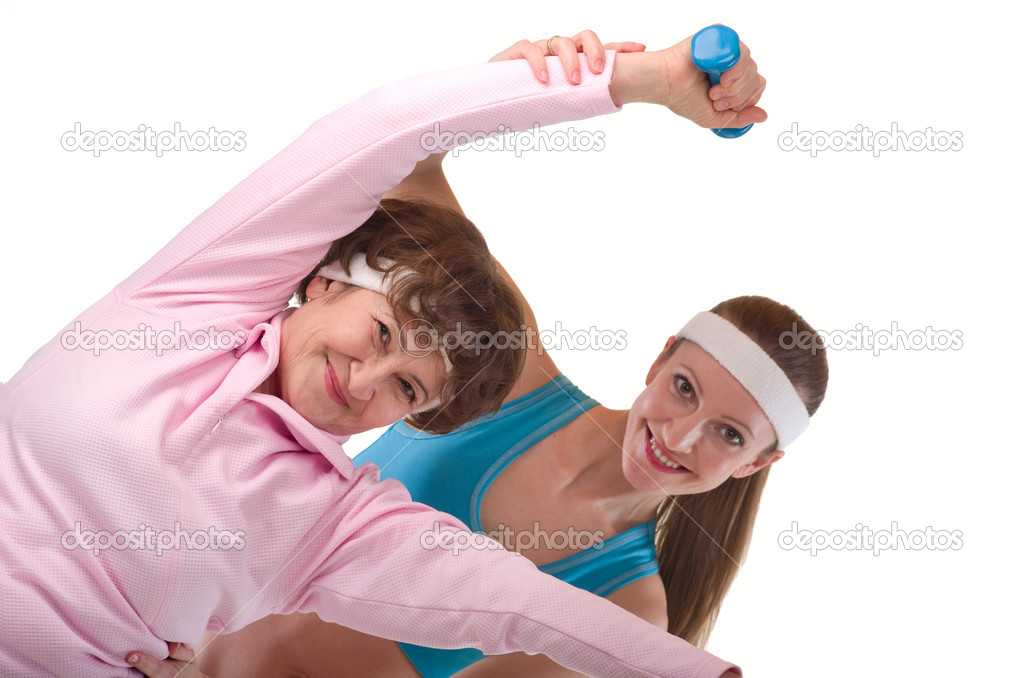 Senior woman exercising in gym with instructor  Stock Photo #5618742