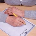 Elderly woman writing testament — Stock Photo