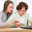 Foto de Stock  : Senior woman with her daughter online purchasing
