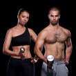 Young couple working out with dumbbells. — Stock Photo