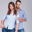 Young fashion expressing couple in jeans — Stock Photo #6268562