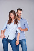 Young fashion expressing couple in jeans — Stock Photo