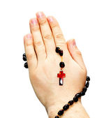Hands on rosary — Stock Photo
