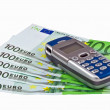 Banknotes and cellular telephone — Stock Photo